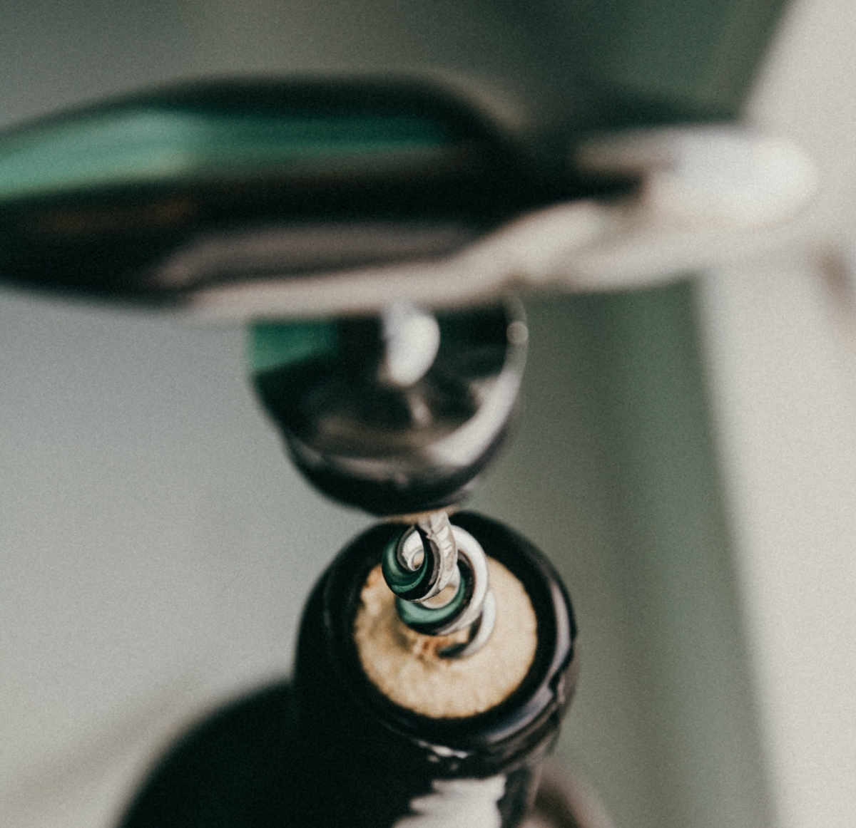Opening A Bottle Of Wine With A Corkscrew