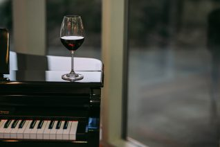 Inexpensive Red Wines wine on piano