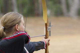 Teenaged Girl Shooting a Recurve Bow
