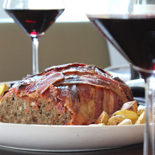 Bacon Wrapped Meatloaf Served With Wine