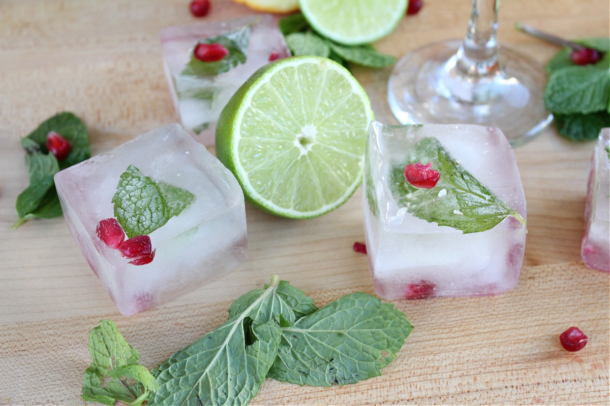 Tequila with Mint Pom Infused Ice Cubes