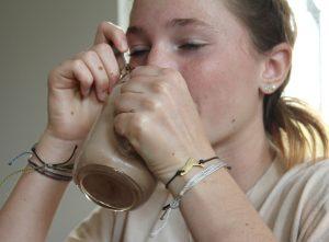 drinking whipped chocolate milk